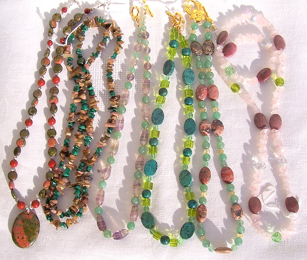 unakite,tourmaline,malachite,red jasper,chrysocolla,aventurine,swarovsky crystalls,leopard skin jasper,rhodonite,rose quartz