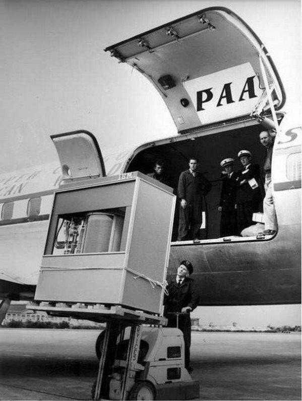 1956 A 5MB hard drive being loaded onto a PanAm plane..jpg
