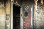 A scorched door at a fire-damaged KTV