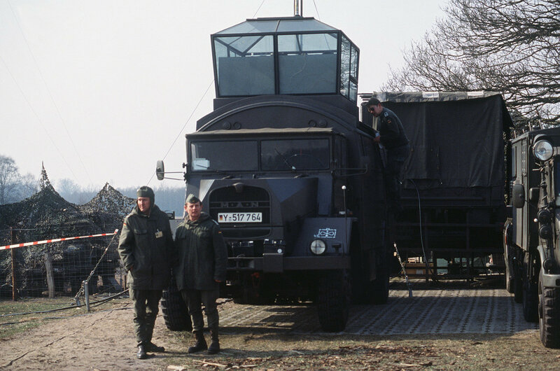 West German soldiers operate a transportable air traffic control tower during an autobahn landing exercise.
