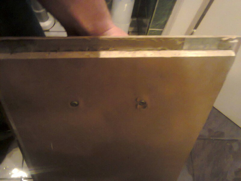 Фото. Гипсокартон раздавлен саморезами крепления ручки люка.