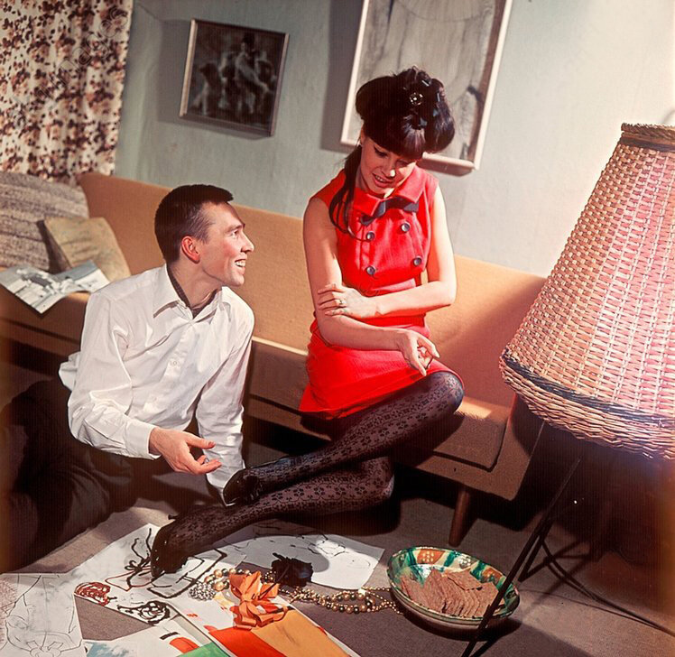 1966 Soviet couturier Slava Zaitsev and model Regina Zbarskaya discuss his latest endeavors, 1966.jpg