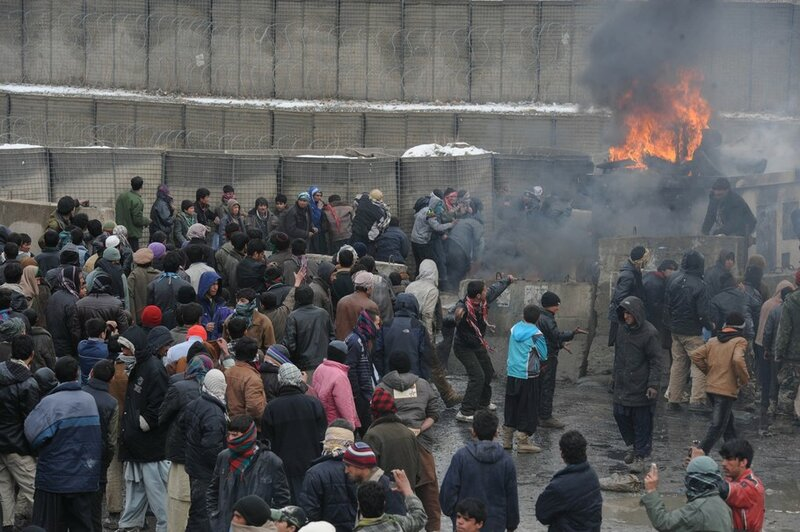Afghan youth throw stones toward US sold