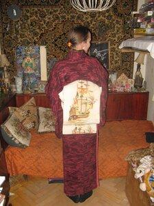 Кибу-сан надевает кимоно и старинный оби