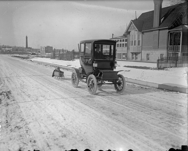 Electric car pulling a kid's sled, Denver, Colorado, between 1910 and 1920