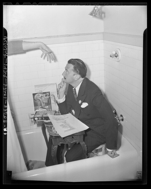 Artist Salvador Dali seated in a bathtub at the Ambassador Hotel in Los Angeles, Calif., 1944