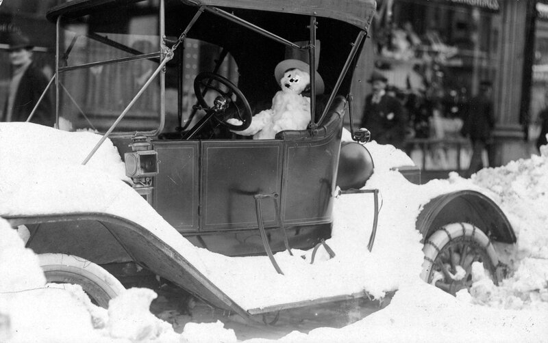 A snowman in the driver's Model T Ford after the snowstorm of December 1913 in Denver, Colorado