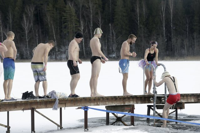 People wait to jump into a cold water pool during the sauna marathon near Otepaa, Estonia, February