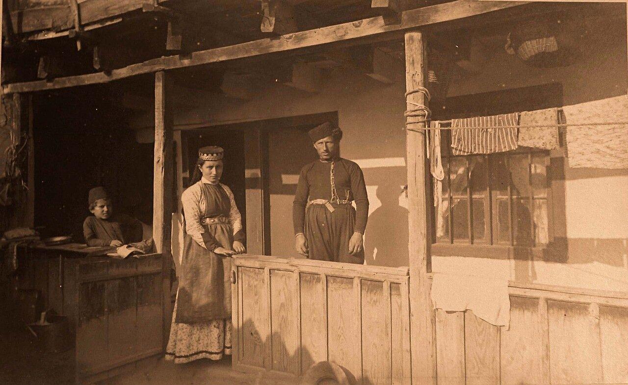 56. Семья крымских караимов в национальных костюмах у входа в дом
