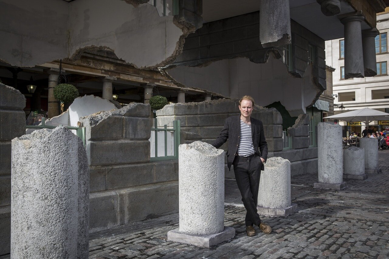 LONDON, ENGLAND - OCTOBER 02:  British artist Alex Chinneck poses for a portrait beside his installation entitled 'Take my lightning but don't steal my thunder' as it stands in Covent Garden on October 2, 2014 in London, England.  The installation is inte