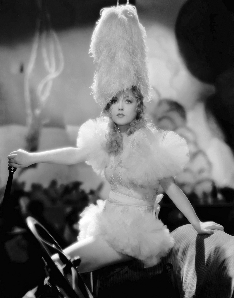 27th June 1932: American actress Marion Davies (1897 - 1961) wearing an extraordinary headdress for the film 'Blondie of the Follies', directed by Edmund Goulding.