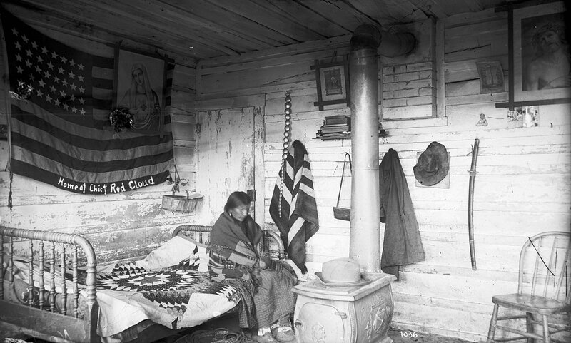 Interior of the frame dwelling built in 1879 for Chief Red Cloud, Native American Oglala Lakota Sioux near the Pine Ridge Agency, South Dakota, 1890 or 1891