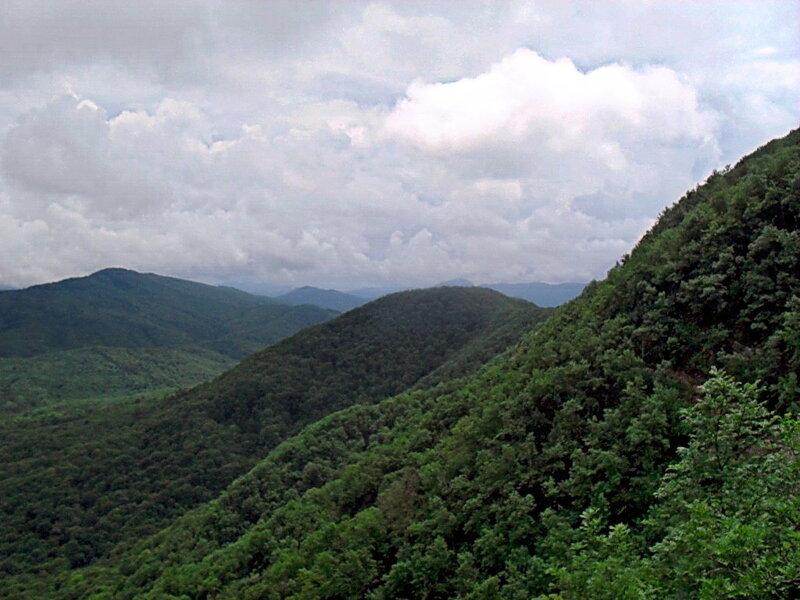 В горах.