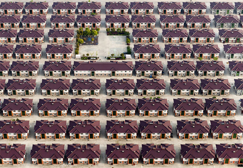 China, Jiangyin, Jiangsu. Rows of identical houses with a playground seen in the middle in the city