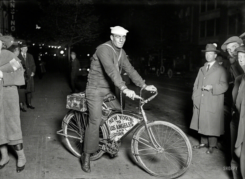 May 1920. Sailor Tony Pizzo passing through Washington on a Coast to Coast bicycle run handcuffed to his machine