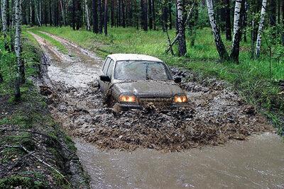 НИВА Шевроле в грязи