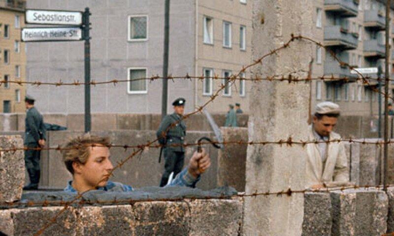 German masons slap mortar on as they build the Berlin Wall in December 1961. Volkmar K. Wentzel.jpg