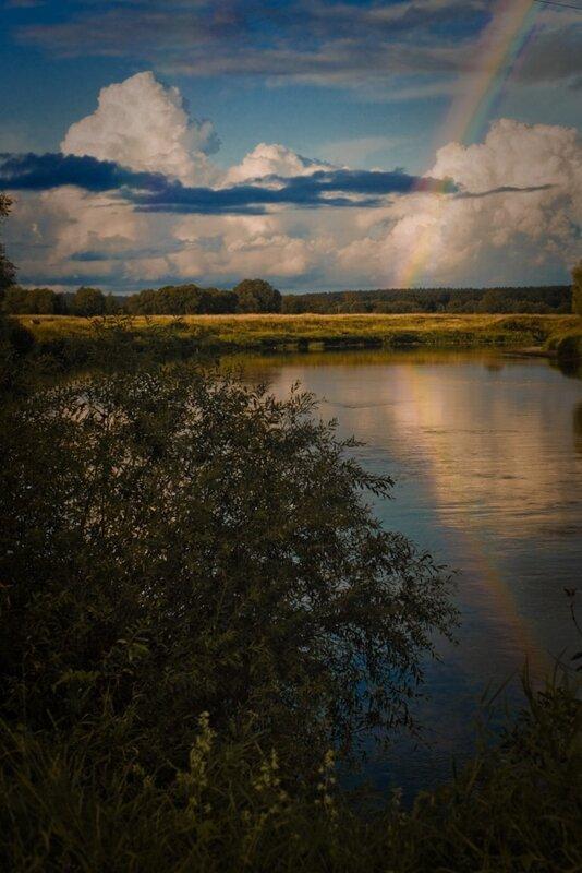 фотография пейзажа с радугой