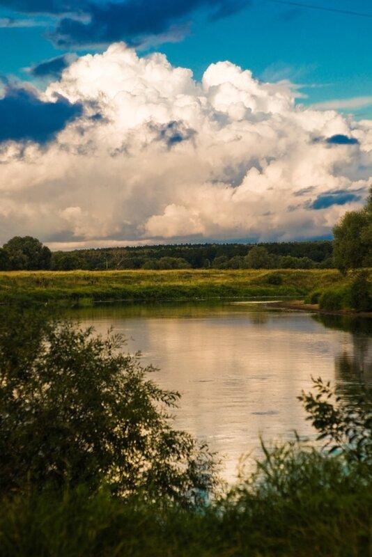 фотография реки Жиздыры и неба после дождя и радуги