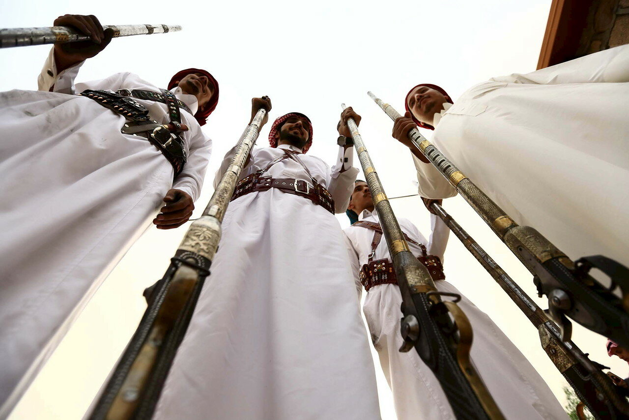 Men pose for a photo during a traditional excursion near the western Saudi city of Taif