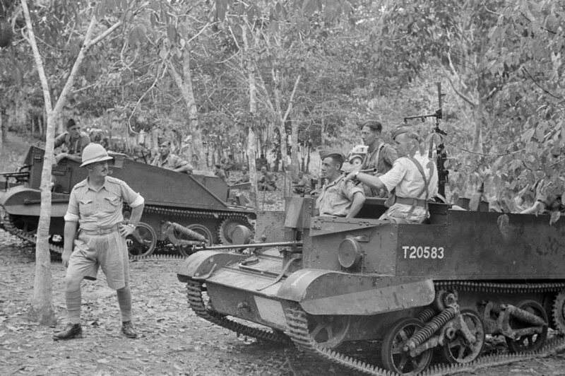 Malaysia_Royal_Artillery_troops_riding_tank_through_jungle.jpg