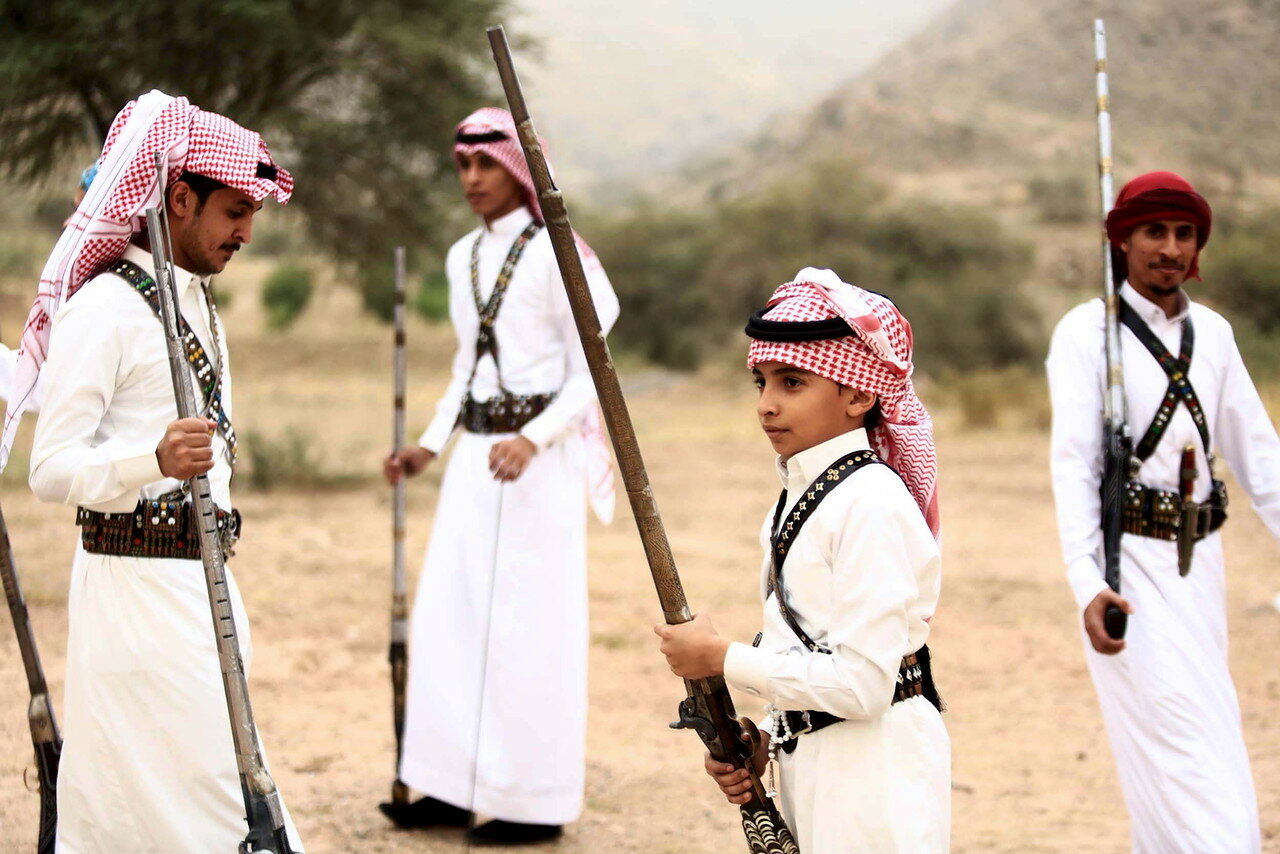 People pose for a photo during a traditional excursion near the western Saudi city of Taif