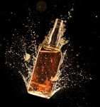Concept of liquor splashing around bottle on black background