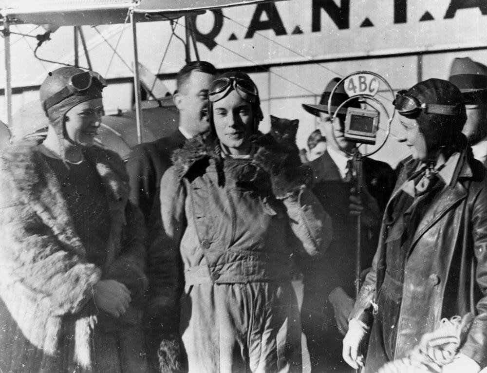 Aviatrix Jean Batten being interviewed after her flight from England to Australia. Archerfield, Brisbane, Australia. 1934