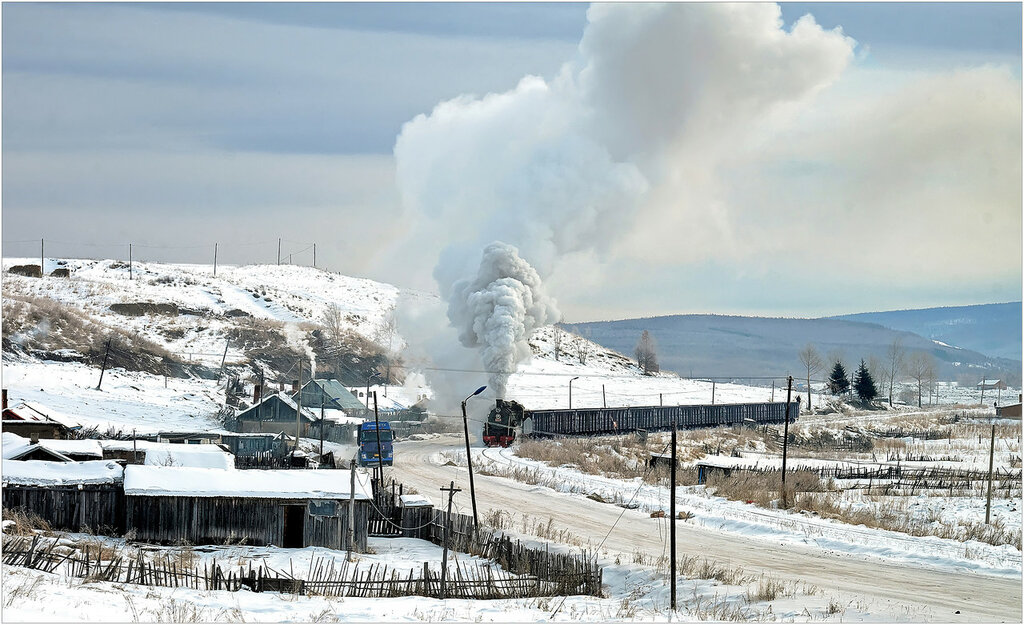 In freezing conditions around -20 degrees, SY1225, is seen with a rake of empty coal box wagons on the Wu Jiu Coal Group line, Inner Mongolia, China. The highlight of the 2017 China trip - Chris Davies