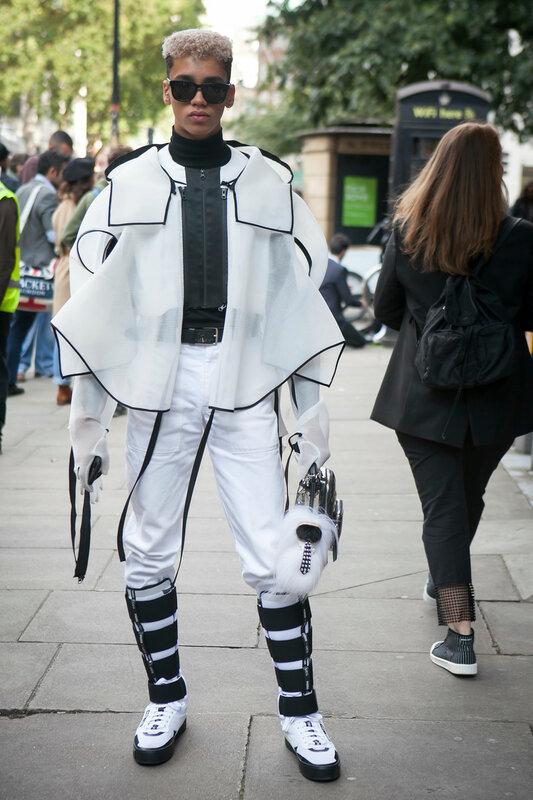 LONDON, ENGLAND - September 15, 2017 Beautiful and stylish man in white coat posing during the London Fashion Week. outside Eudon Choi