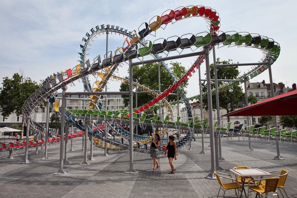 Hundreds of Colorful Cafe Chairs Take the Form of a Winding Roller Coaster in the Middle of a French Square