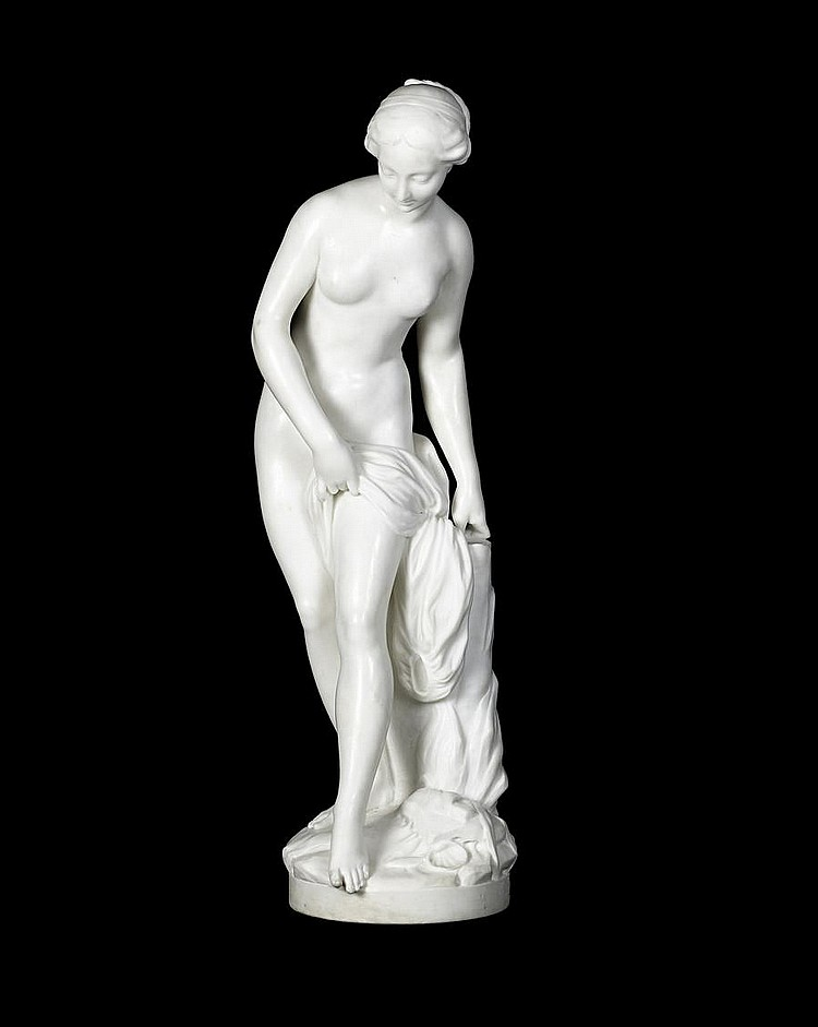 A Carrara marble figure of a nude bathing.jpg