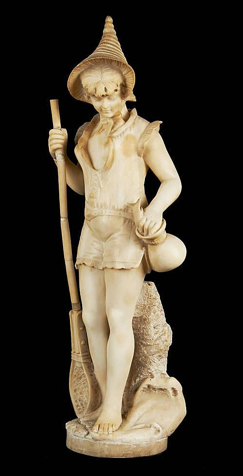 An alabaster figure of a young girl fishing.jpg