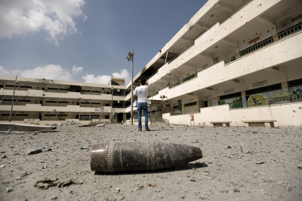 6. Брошенный автомобиль в городе Газе, 6 августа 2014. (Фото Mohammed Abed | AFP | Getty Images):