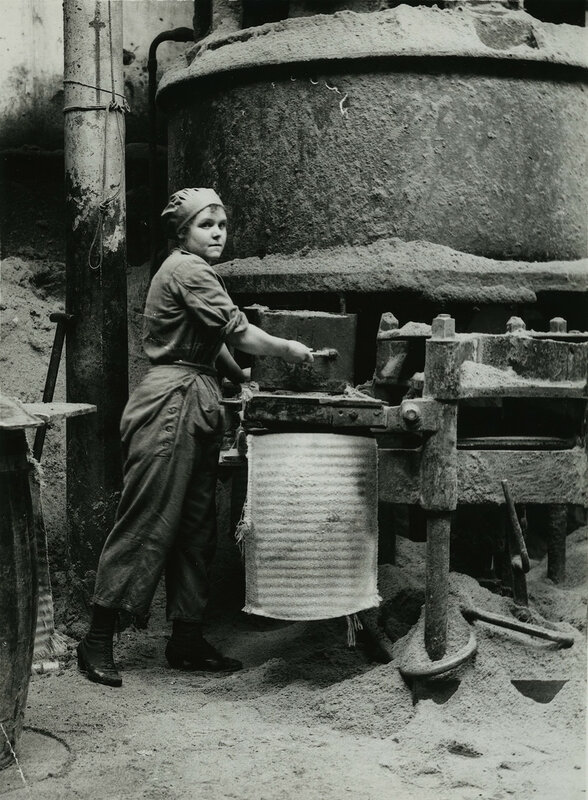 British women oil workers in Lancashire moulding cakes