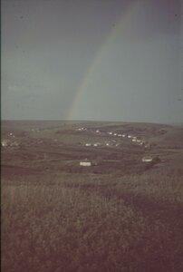 Пейзаж с деревней и радугой