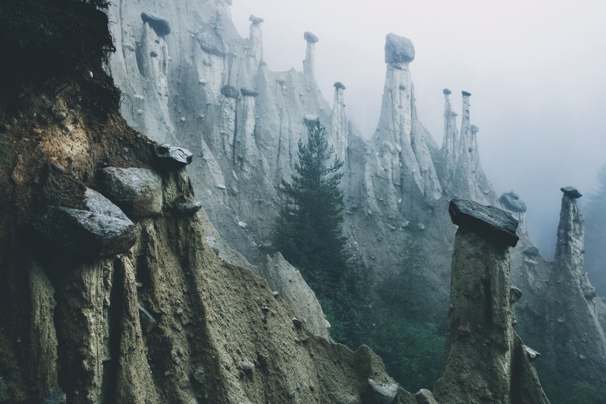 Otherworldly 'Earth Pyramids' Captured in the Foggy Early Morning Light by Photographer Kilian Schonberger