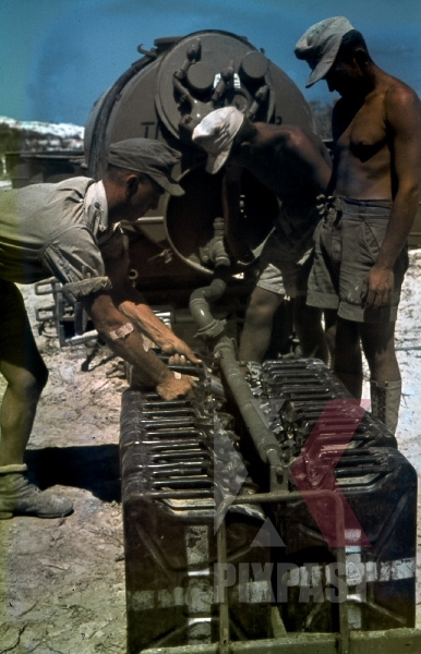 stock-photo-rommels-afrika-korp-soldiers-filling-petrol-jerrycans-in-quai-charles-quint-la-goulette-tunisia-1942-12453.jpg