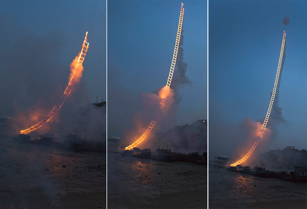 Artist Cai Guo­-Qiang Sends a 500-Meter Ladder of Fire into the Sky Above China
