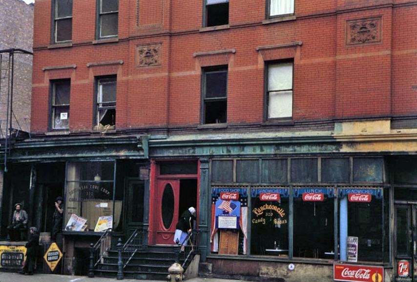 Store-fronts-below-brick-tenement-19421.jpg