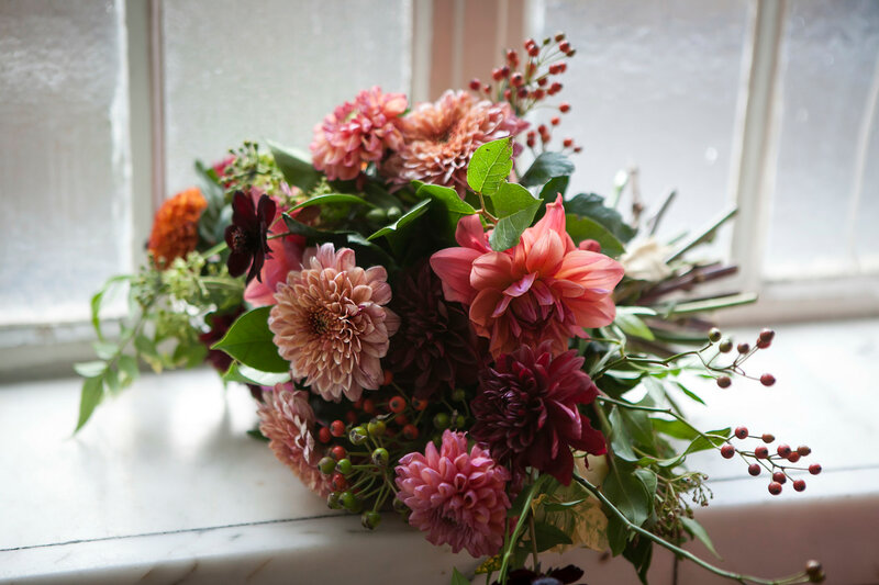 bouquet of dahlias and roses lying on the window sill