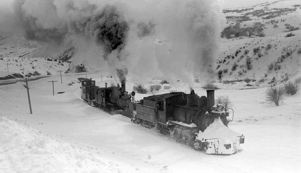 D&RGW train (Narrow Gauge), engine number 360 and engine number 361, engine type 2-8-0, above Cimarron, Colo., February 22, 1940.