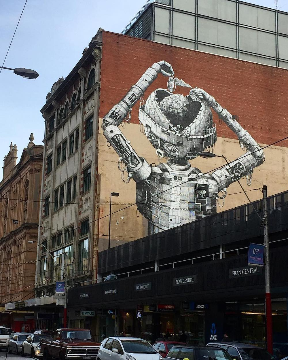 This past month, Sheffield-based artist Phlegm ( previously ) revealed his latest mural, a 5-story