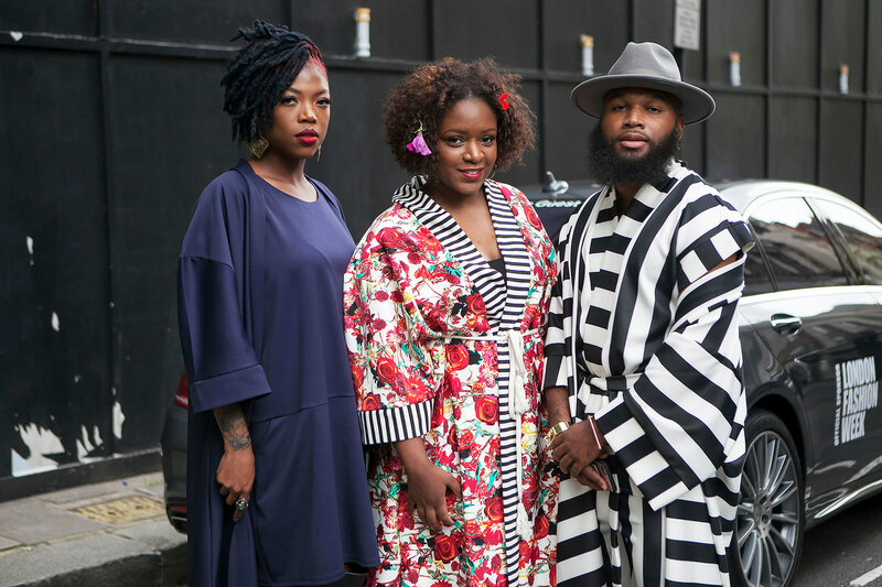 Beautiful and stylish Three friends dressed in ethnic clothes  posing during the London Fashion Week. outside Eudon Choi