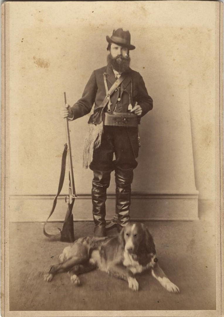 Портрет охотника со спаниелем