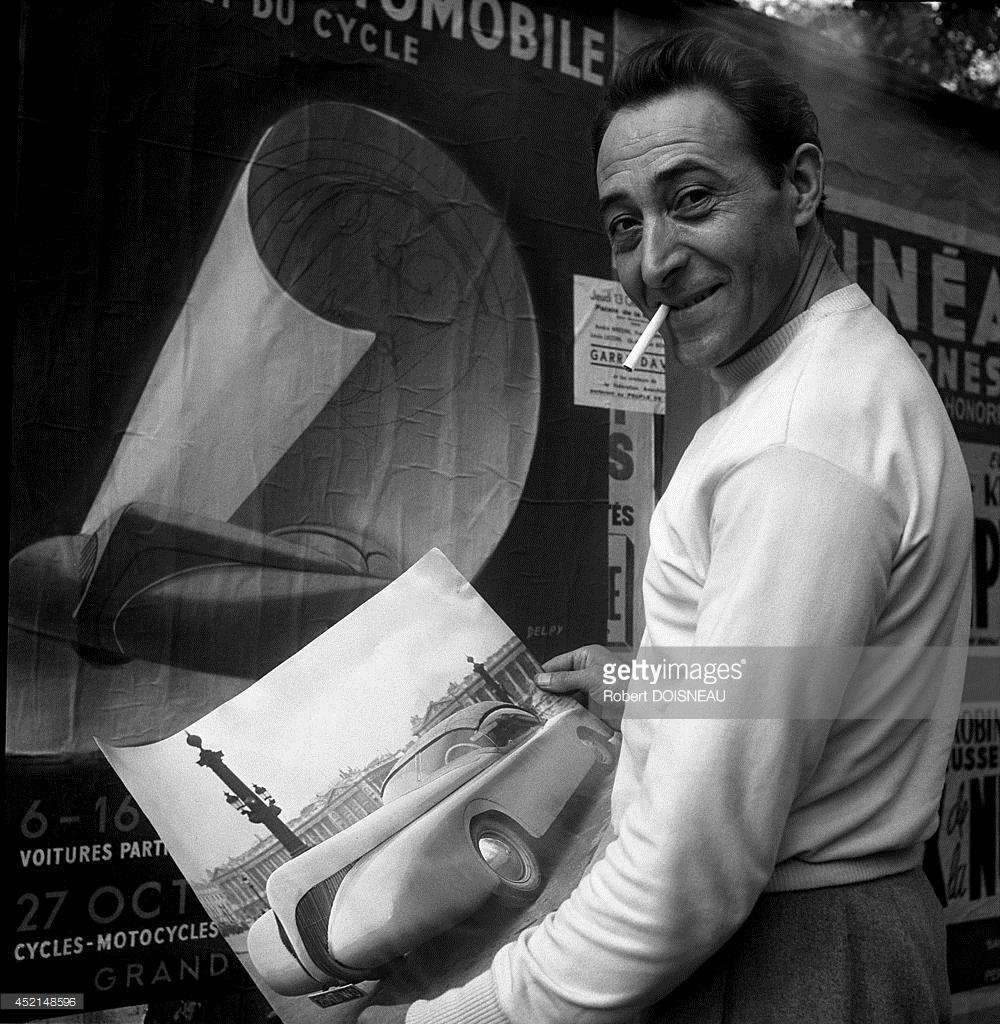 1949. Французский художник - конструктор железнодорожных локомотивов и легковых автомобилей Поль Арзенс с фотографией своего кабриолета «La Baleine»