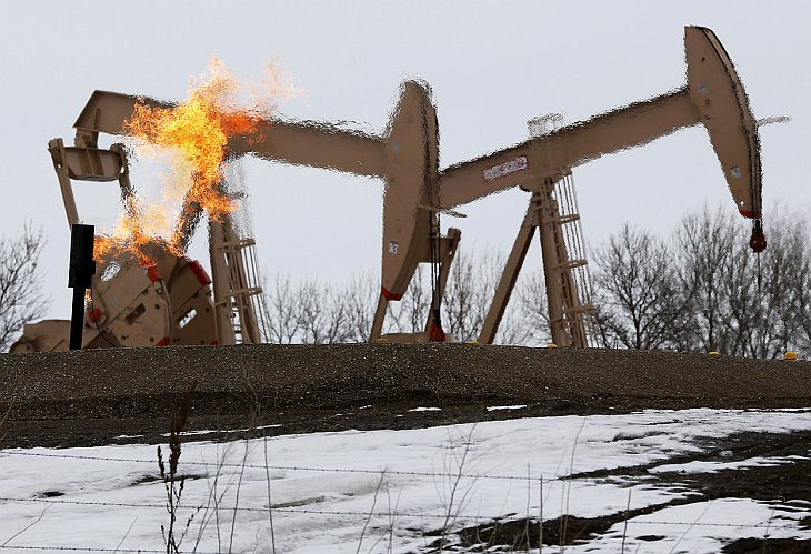Нефтяник. Северная Дакота, 20 октября 2012. (Фото Jim Urquhart | Reuters):