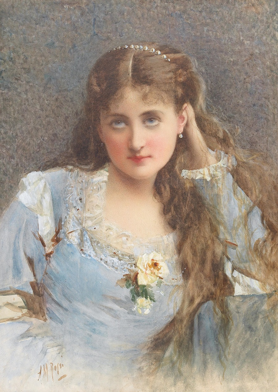 A portrait of a young woman with her hair open and dreamy eyes