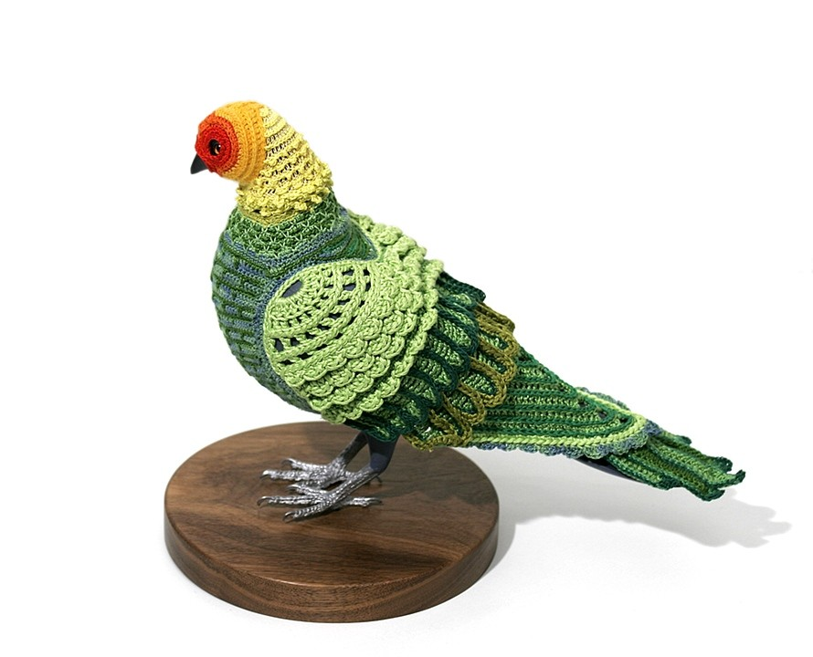 Carolina Parakeet, 2009. Crocheted yarn, hand carved pigeon mannequin, walnut stand.