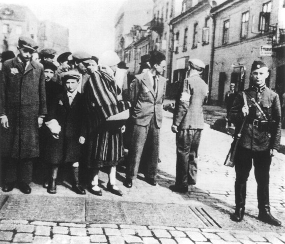 German soldier with Jewish order Police and deportees.jpg